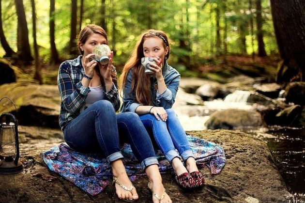 Girls drinking coffee on forest