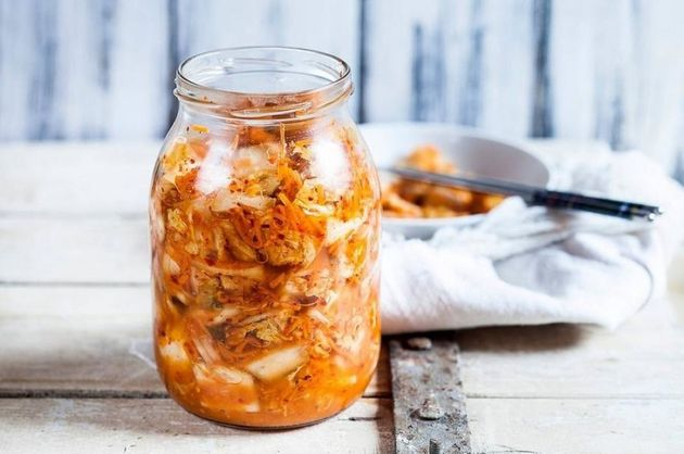 Glass of homemade Korean Kimchi with chinese cabbage, scallions and