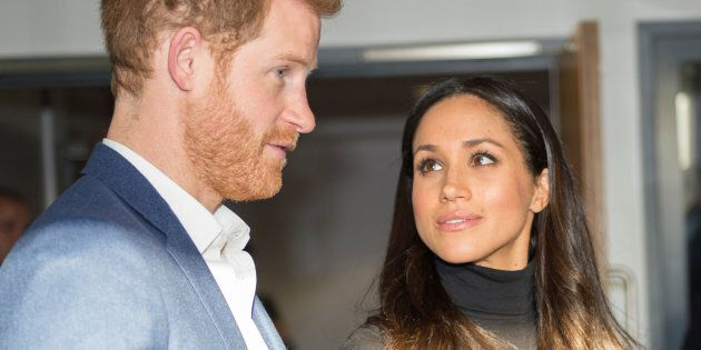 Britain's Prince Harry and his fiancee Meghan Markle visit the Nottingham Academy school in Nottingham,...