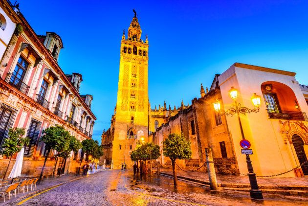 Seville, Andalusia, Spain. Cityscape twilight image with Santa Maria de la Sede Cathedral and