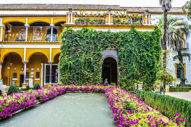Seville, Spain - August 12, 2015: The facade and gardens of Casa de
