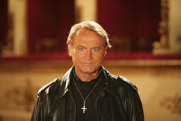 Close-up of Italian actor Terence Hill (Mario Girotti) playing the priest while shooting on the set of...