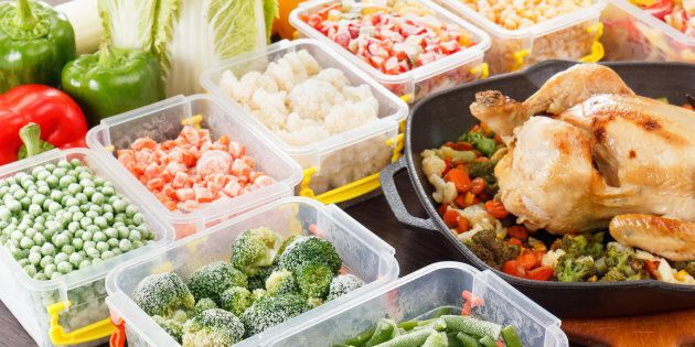 Stir fry vegetables frozen in plastic container, roasted chicken and veggies. Healthy freezer food in