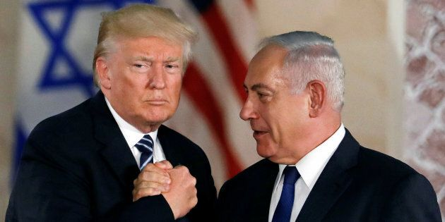 U.S. President Donald Trump and Israeli Prime Minister Benjamin Netanyahu shake hands after Trump's address...