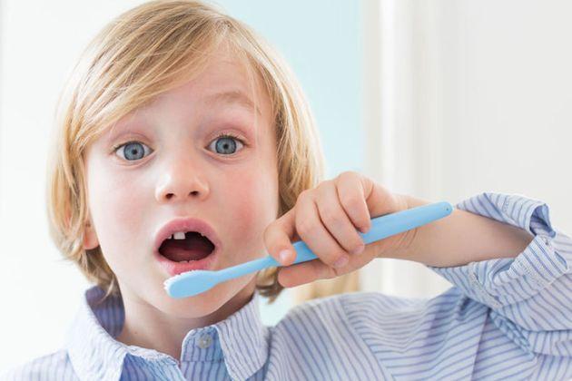 7 year old boy brushing his