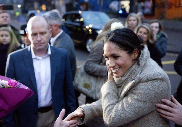 LONDON, UNITED KINGDOM - JANUARY 9: Prince Harry's fiance Meghan Markle (R) greet the crowd as they arrive...