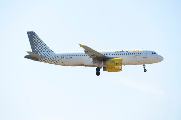 An airplane of the Spanish low-cost airline Vueling prepares to land at Barcelona's airport in El Prat...