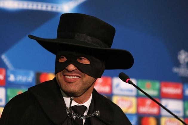 Shakhtar Donetsk's Portuguese manager Paulo Fonseca, wearing a Zorro mask and hat, delivers a press conference...