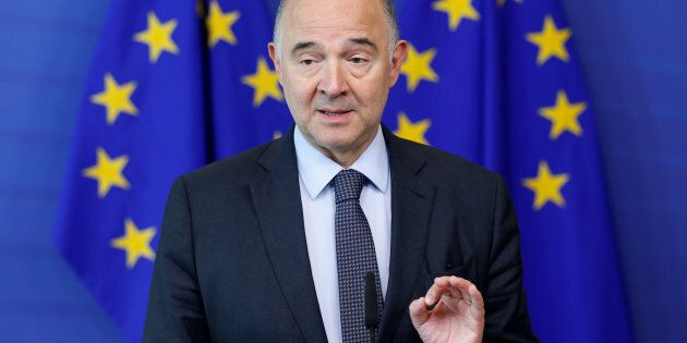 European Economic and Financial Affairs Commissioner Pierre Moscovici holds a news conference at the...