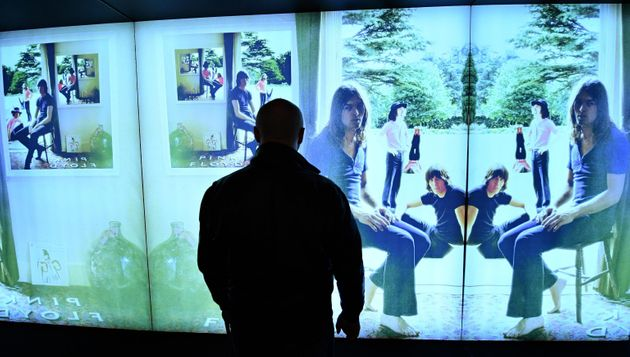 A visitor looks at a giant photograph from the Ummagumma album during a preview of The Pink Floyd Exhibition:...