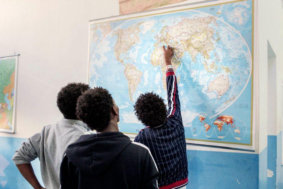 Pozzallo. Sicily, Ap. 25, 2014. Italy. Three Eritrean adolescents inside the CPSA (Centro di primo soccorso...