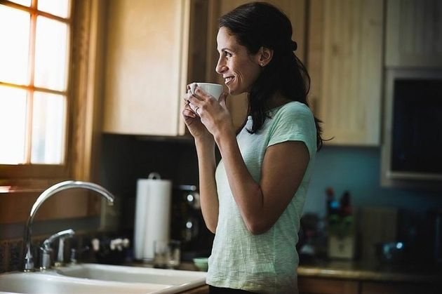 Woman drinking coffee in