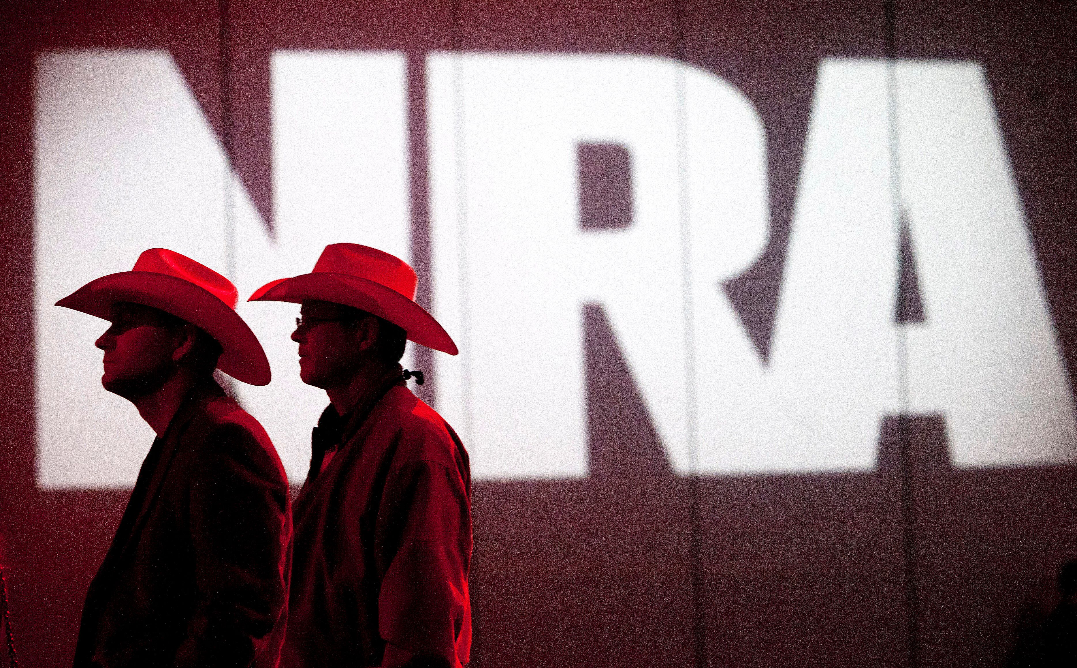 FILE - In this May 4, 2013, file photo, NRA members listen to speakers during the NRA Annual Meeting of Members at the National Rifle Association's 142 Annual Meetings and Exhibits in the George R. Brown Convention Center in Houston. The National Rifle Association is gathering for its 148th annual meeting beginning Thursday, April 25, 2019, in Indianapolis. (Johnny Hanson/Houston Chronicle via AP, File)