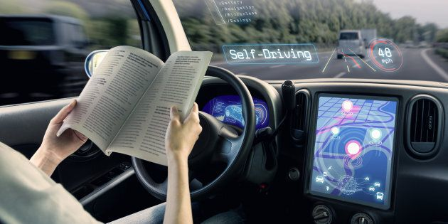 cockpit of autonomous car. a vehicle running self driving mode and a woman driver reading