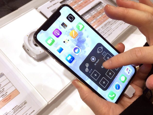 Apple's new iPhone X is displayed after it goes on sale at the Apple Store in Tokyo shopping district,...