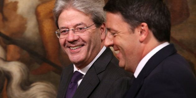 Newly appointed Italian Prime Minister Paolo Gentiloni (L) and his predecessor Matteo Renzi arrive to...