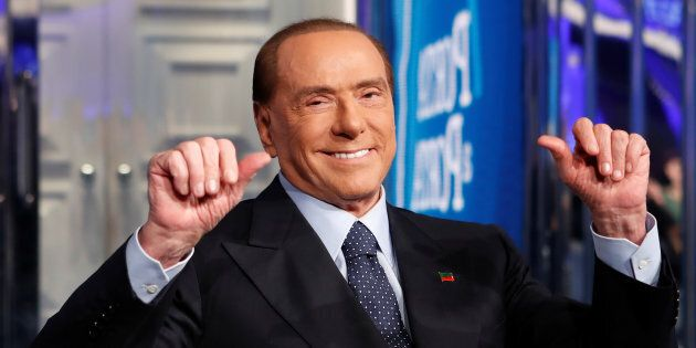 Italy's former Prime Minister Silvio Berlusconi gestures during the taping of the television talk
