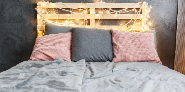 Cozy dreamy bed with decorated DIY pallet