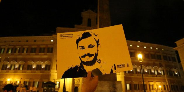 REFILE-CORRECTING BYLINE A man holds a placard during a vigil to commemorate Giulio Regeni, who was found...