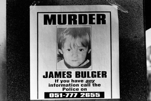 Police poster featuring a pic of 2-yr-old murder victim James Bulger, seeking assistance in finding his...