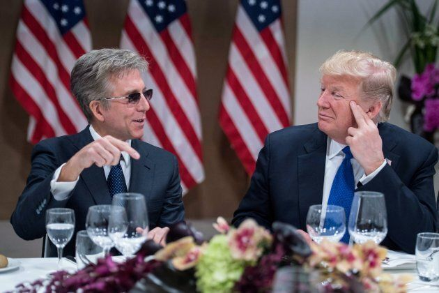 US President Donald Trump (R) listens to SAP CEO Bill McDermott during a working dinner with European...