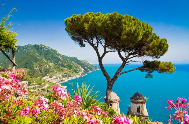 Scenic picture-postcard view of famous Amalfi Coast with Gulf of Salerno from Villa Rufolo gardens in...