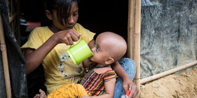 On 20 November 2017 in Bangladesh, severely malnourished Rohingya refugee 10-month-old Atica, sips water...
