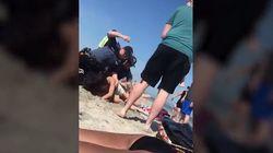 Beve birra in spiaggia: i poliziotti la prendono a pugni e la