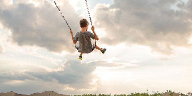 Boy swinging on