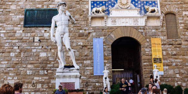 FLORENCE, ITALY - 2017/08/19: Replica of Michelangelo's David and other statues in Piazza della Signoria....