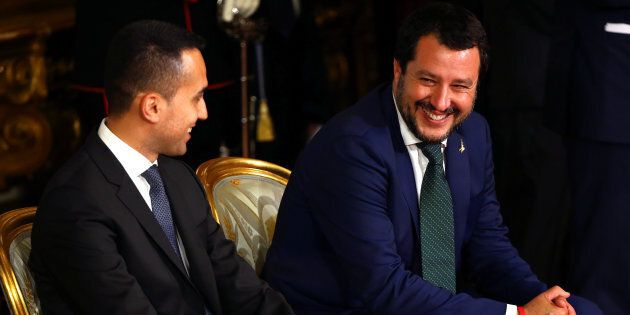 Italy's Minister of Labor and Industry Luigi Di Maio smiles next to Interior Minister Matteo Salvini...