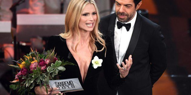 Swiss-Italian TV showgirl Michelle Hunziker (L) and Italian actor Pierfrancesco Favino (R) on stage during...