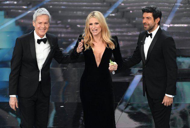 Italian singer and Sanremo Festival artistic director Claudio Baglioni (L), Swiss-Italian TV showgirl...