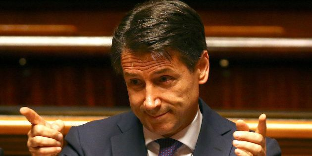 Newly appointed Italian Prime Minister Giuseppe Conte gestures during his first session at the Senate...