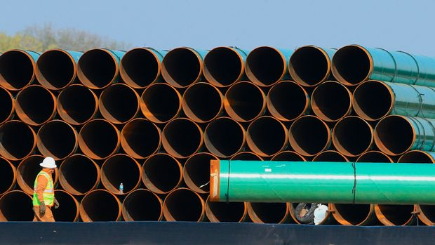 Pipes for the proposed Dakota Access oil pipeline, that would stretch from the Bakken oil fields in North Dakota to Patoka, Ill., are stacked Saturday, May 9, 2015, at a staging area in Worthing, S.D. The proposed oil pipeline will traverse North and South Dakota, Iowa and Illinois. (AP Photo/Nati Harnik)