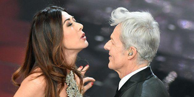 Italian singer and Sanremo Festival artistic director Claudio Baglioni (R) with Italian actress Virginia...