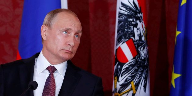 Russia's President Vladimir Putin looks on during a joint news conference with Austria's President Alexander...
