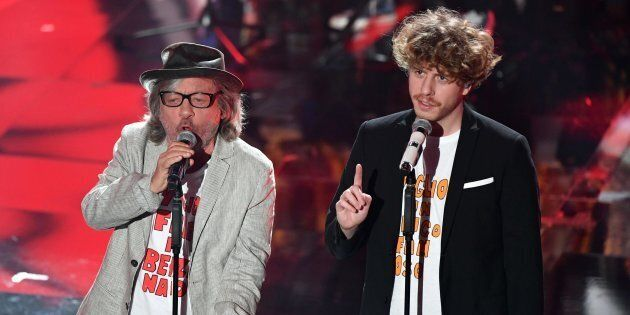 Italian band Lo Stato Sociale with Italian actor Paolo Rossi (L) perform on stage during the 68th Sanremo...
