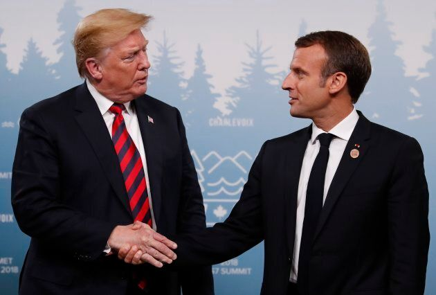 U.S. President Donald Trump shakes hands with France's President Emmanuel Macron during a bilateral meeting...