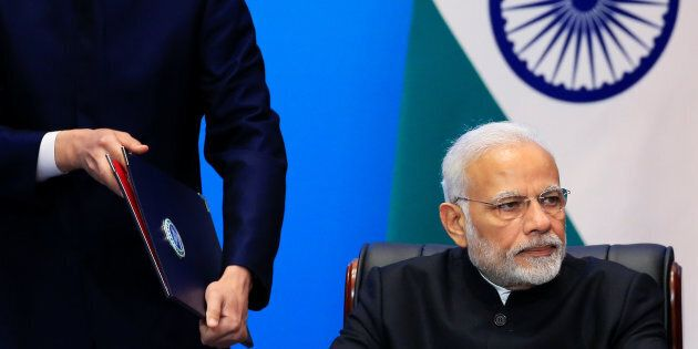 India's Prime Minister Narendra Modi attends a signing ceremony during Shanghai Cooperation Organization...