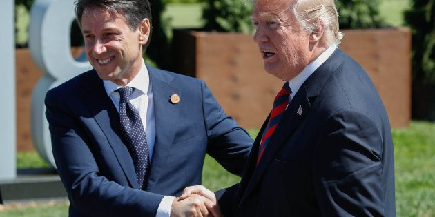 Italy's Prime Minister Giuseppe Conte shakes hands with U.S. President Donald Trump after a family photo...