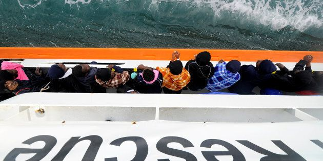 Migrants wait to disembark from Aquarius in the Sicilian harbour of Catania, Italy, May 27, 2018. REUTERS/Guglielmo...