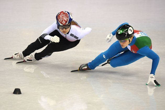(L-R) South Korea's Choi Minjeong and Italy's Arianna Fontana compete in the women's 500m short track...