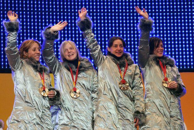 Turin, ITALY: Bronze medallist Marta Capurso, Arianna Fontana, Katia Zini and Mara Zini of Italy wave...