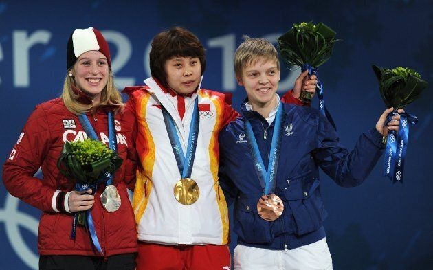 (L-R) Canada's silver medalist Marianne St-Gelais, China's gold medalist Meng Wang and Italy's bronze...