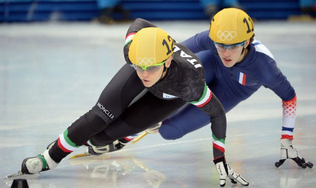 Italy's Arianna Fontana (L) and France's Veronique Pierron compete in the Women's Short Track 1000 m...
