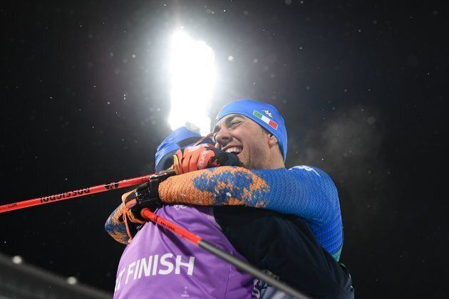 Italy's Federico Pellegrino is congratulated after winning silver in the men's cross-country individual...