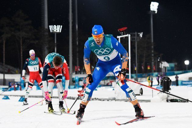 Italy's Federico Pellegrino crosses the finish line to win silver in the men's cross-country individual...