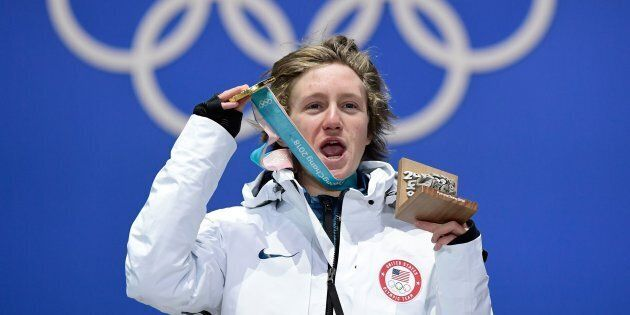 USA's gold medallist Redmond Gerard poses on the podium during the medal ceremony for the snowboard Men's...