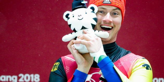 PYEONGCHANG, SOUTH KOREA FEBRUARY 11, 2018: Luger Johannes Ludwig of Germany holds a plush toy of the...